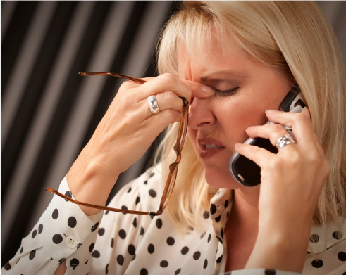 Managing stress and building resilience from the Welbee learning centre. Adapt to your stressors - picture of a woman on phone with stress and thinking about how to adapt to the situation.