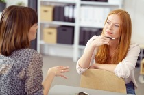 Managing stress and building resilience from the Welbee learning centre. Accept your stressors - picture of a woman expressing her feelings to another.