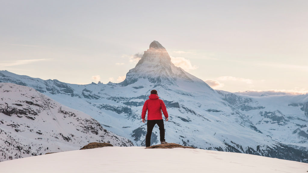 Improve staff wellbeing by setting clear goals - picture of a mountain to climb