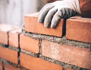 Resilience and wellbeing toolkit from the Welbee Learning Centre. A picture of a brick wall. Like resilience it takes time to build.