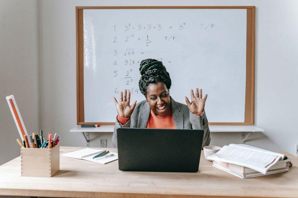 Happy teacher in front of wipe board